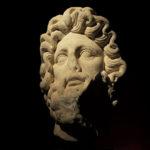 Testa in marmo raffigurante Zeus (Fara Filiorum Petri, CH, II sec. d.C.).